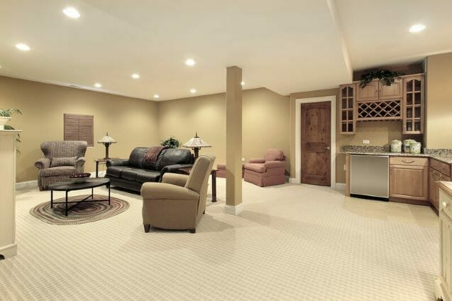 remodeled basement,carpeted, bar area and four comfy chairs