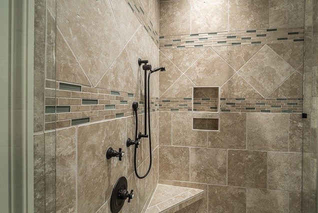 shower with modern mosaic tile,black fixtures and triangular bench